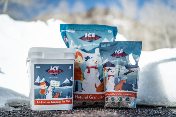 Containers of Ice Slicer Nature's Blend granular deicer