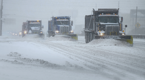 Snow Plows working in an echelon formation