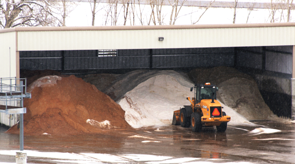 Shed with stockpiles of road deicing treatments