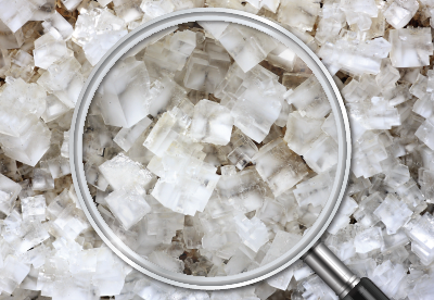 Magnifying glass and sodium chloride crystals