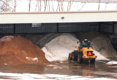 Ice melt storage piles in a 3 sided shed